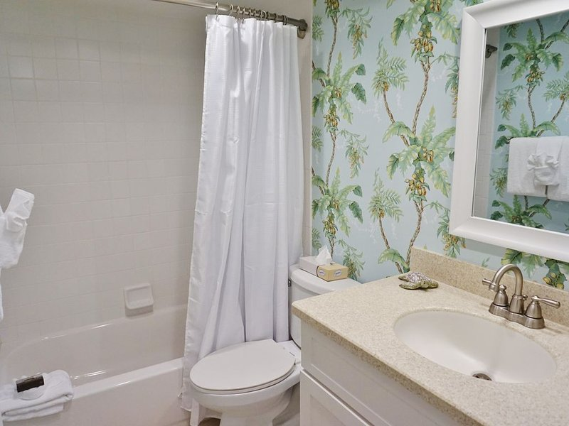 Full Bathroom with a Bath and Shower