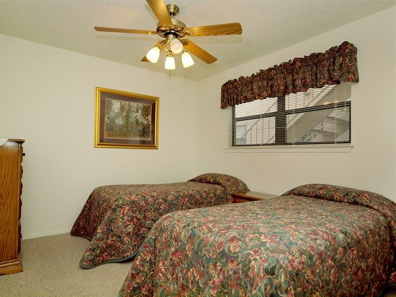 Guest Bedroom - The guest bedroom has 2 twin beds which is perfect if you're traveling with children!