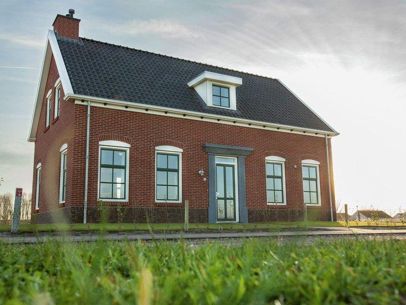 Spacious Villa in Colijnsplaat with Sauna, vacation rental in Wolphaartsdijk