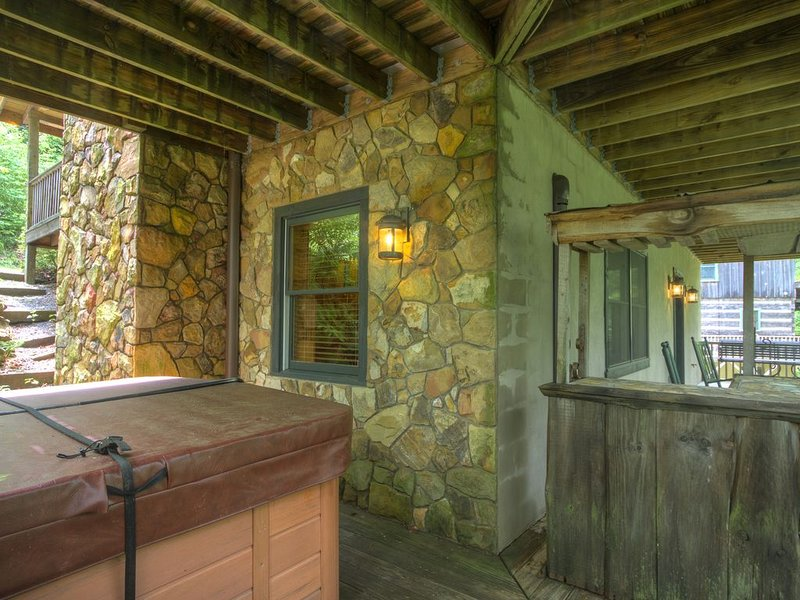 Hot tub on lower covered porch