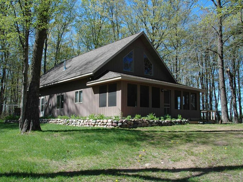 This home is a wonderful escape in the woods and available for shorter stays!, holiday rental in Cable
