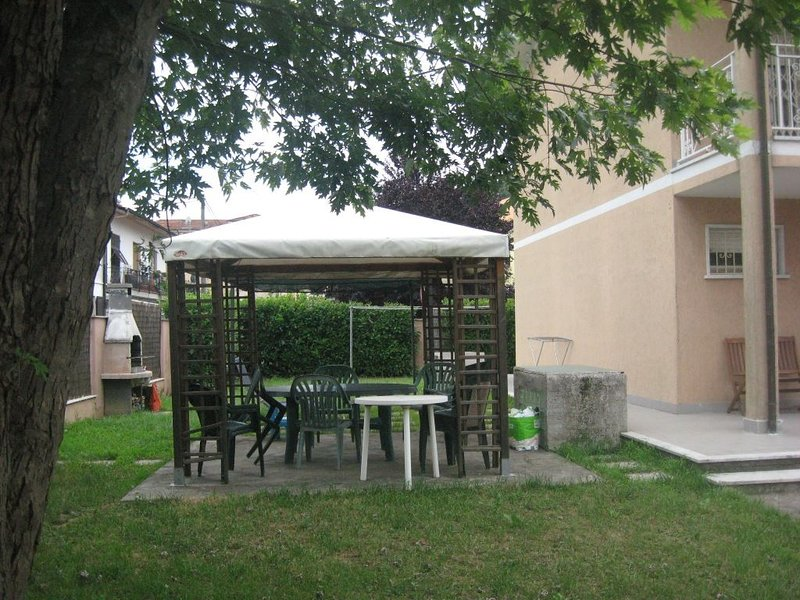garden with gazebo and barbecue