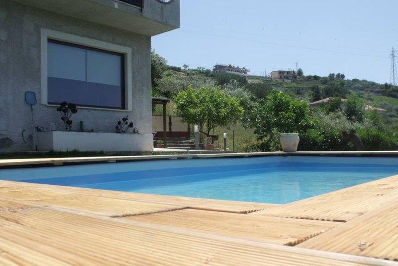 casa nel verde con piscina, location de vacances à Agropoli