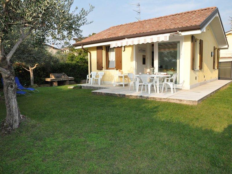 Villetta in Bardolino Calmasino in residence con due piscine, alquiler vacacional en Cisano