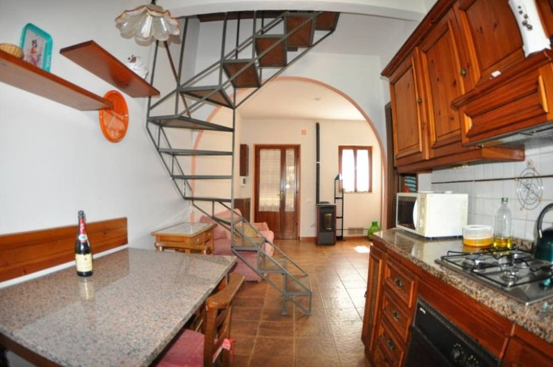 Small town house with garden, holiday rental in Madonna Dell'Acqua
