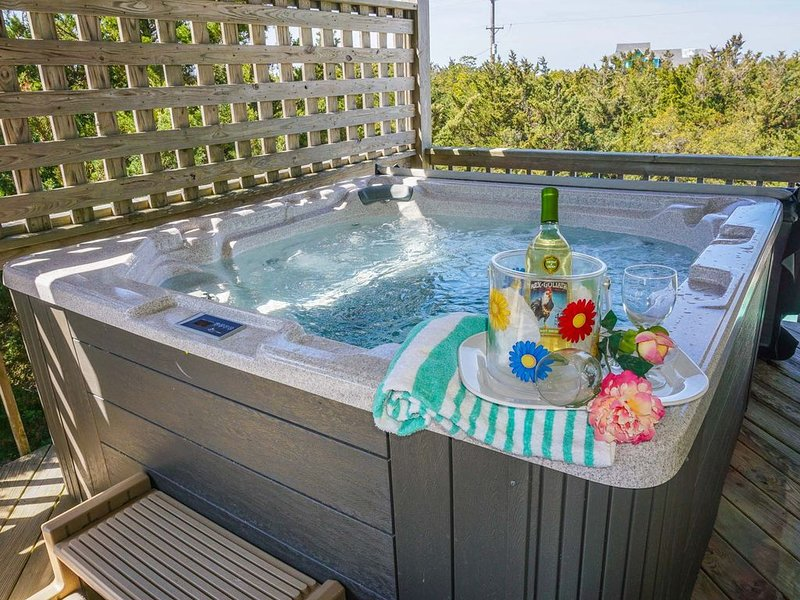 6 person hot tub is located on the middle level with views of the ocean.