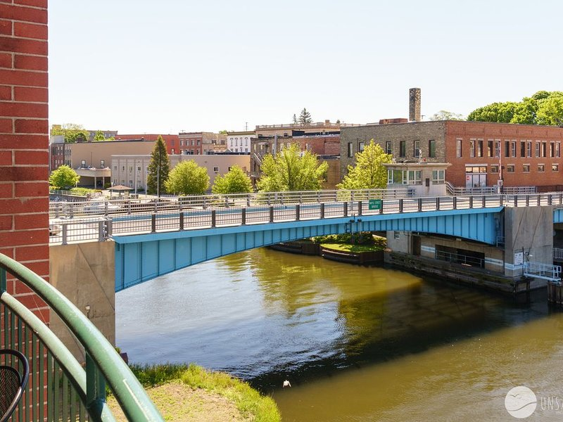 Condo w/ Spacious Balcony Perched along the Manistee River!, holiday rental in Manistee County