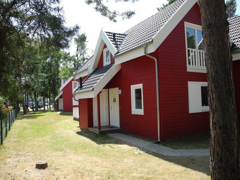 Neues, strandnahes Ferienhaus m. Badewanne, Infrarotsauna, Kaminofen u. WLAN, holiday rental in Neuenkirchen