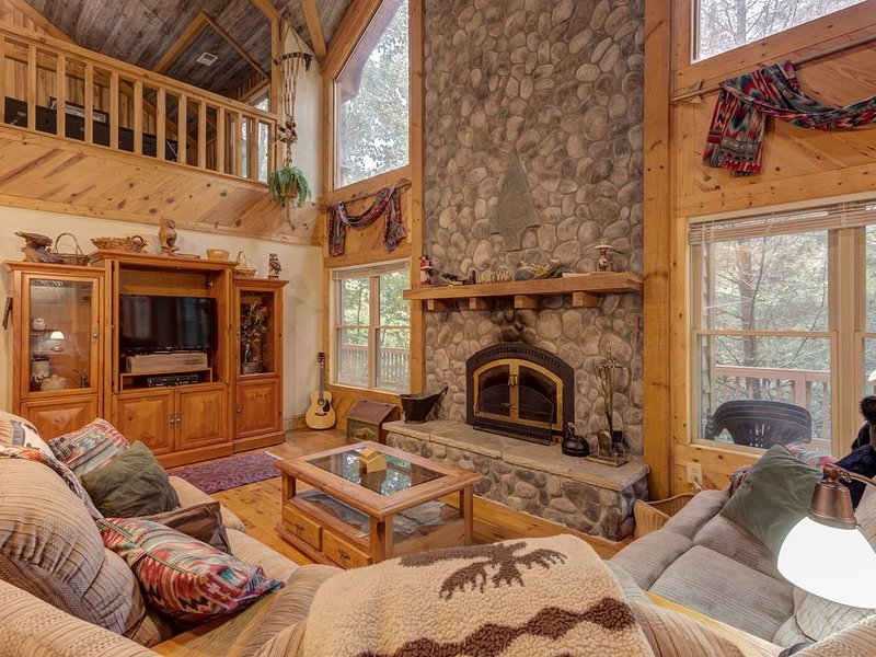 Dog-friendly riverfront cabin w/ waterfall view, large decks, firepit, Ping-Pong, holiday rental in Wiley