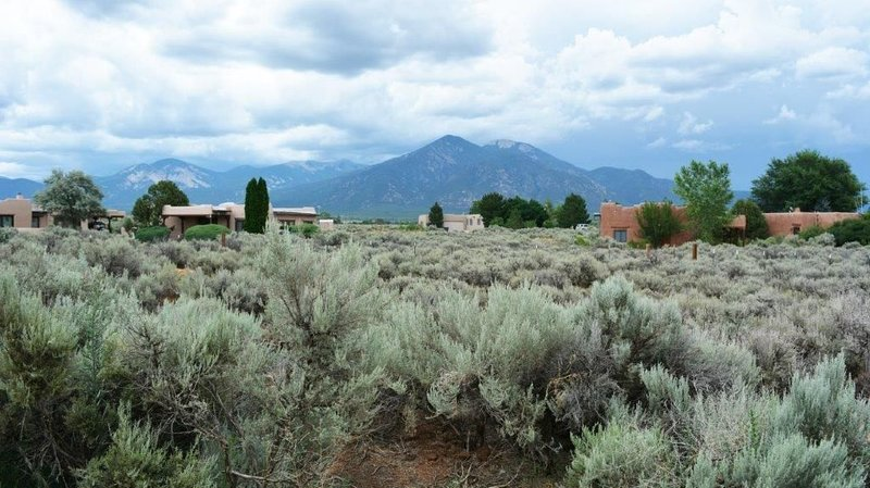 Viewing sage brush open acreage to Taos mountain