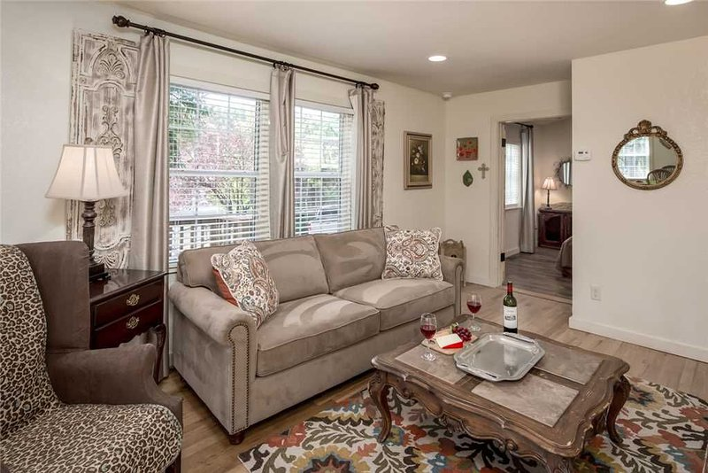 Living Room - Plush comfort and classic wooden floors will feel wonderful on your weary feet after a long day of hiking, shopping, or skiing.