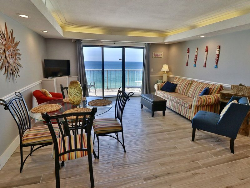 Open living and dining room with a breathtaking view of PCB.