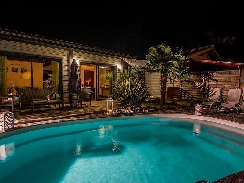 Maison en bois, piscine chauffée et spa, proche lacs et océan., vacation rental in Biscarrosse