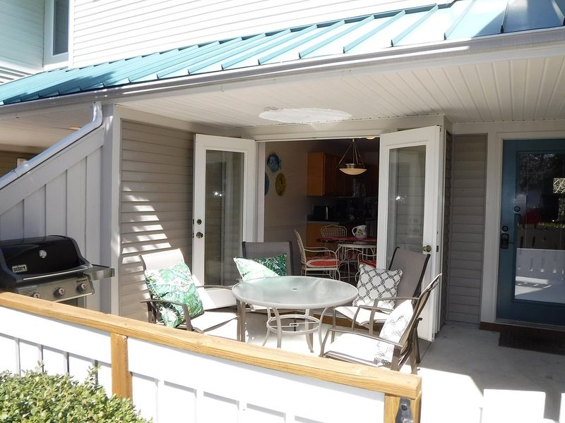 Patio just outside the kitchen. Enjoy morning coffee and easy access to grill