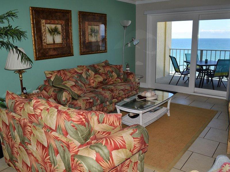 Living room overlooks the Emerald coast and sandy white beach!