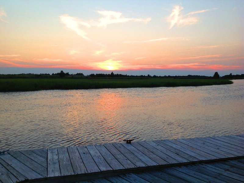 Sunset of Refuge at high tide while sitting on bench seats of your private dock.