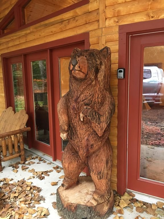 Big Bear stands guard over the cabin.