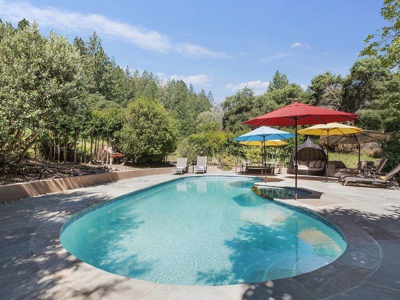 Heated pool with plenty of shade, lounge chairs, and cabana