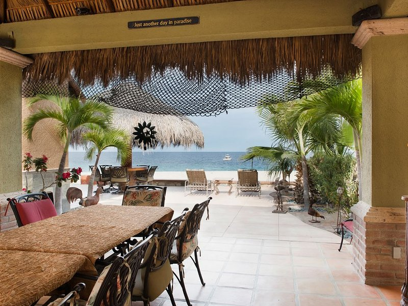 View to beach and amazing sea of corteze through outdoor living Palapa room