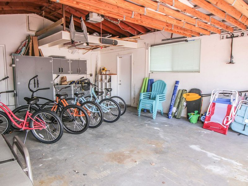 Five bicycles, beach gear, chaise lounges, chairs and fishing poles for your use