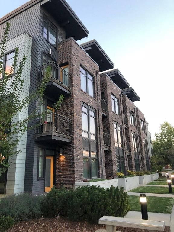 Modern Townhome End Unit.  Home is left most unit with yellow door.
