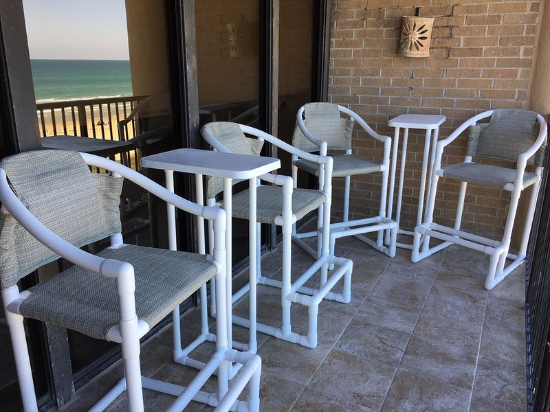 Relax on the beachfront deck enjoying your favorite beverage.