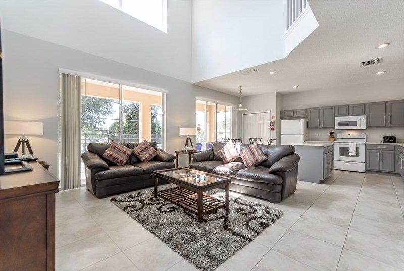 Modern family room with 18 feet high ceiling, full of sun light.