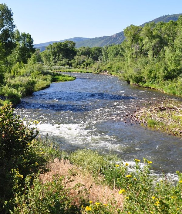 The Roaring Fork River, excellent fly fishing right on the property!