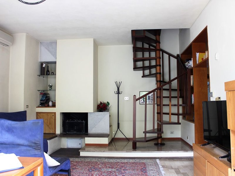 living room and dining room, fireplace, television