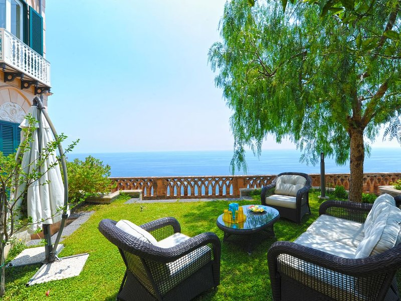 Sea view garden equipped with armchairs and parasol