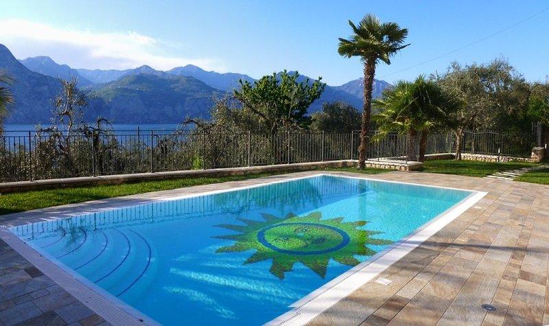 Appartamento 'Sole' - Elegante appartamento con piscina e vista lago – semesterbostad i Brenzone sul Garda
