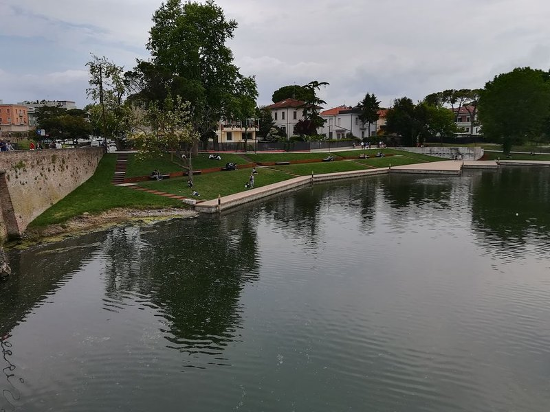 The square on the water, between the Tiberius bridge and the Marecchia Park