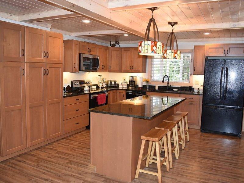 Beautiful kitchen completely stocked.