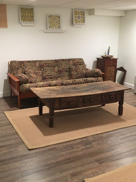 Newly remodeled basement with full futon and full bath with tub/shower combo.