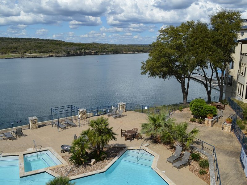 Pool and hot tub with the lake behind and Pace Bend Park in background
