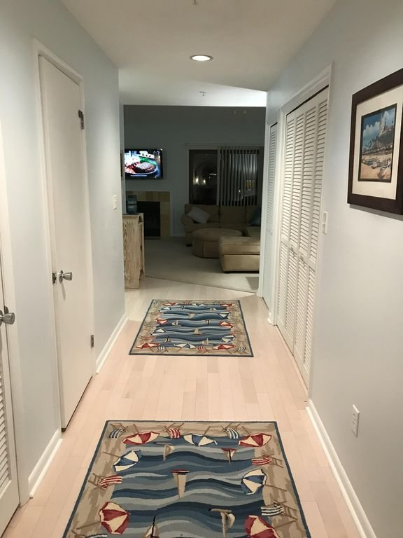 Hallway leading to great room and kitchen.