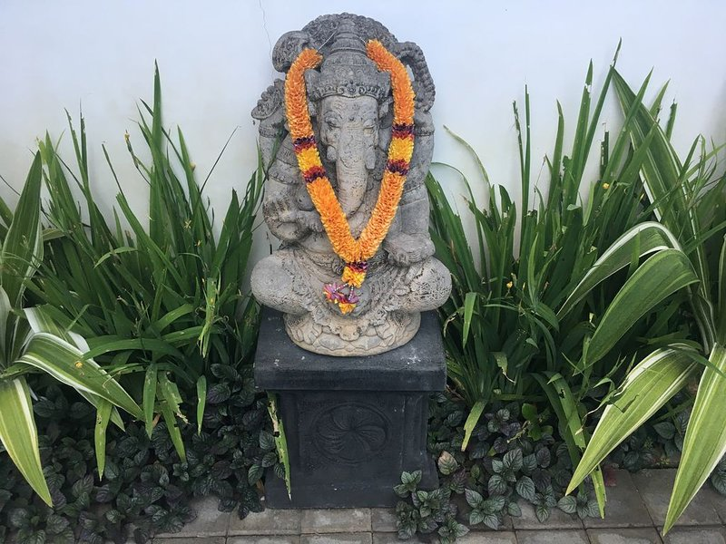 Ganesha status at the entrance to the house