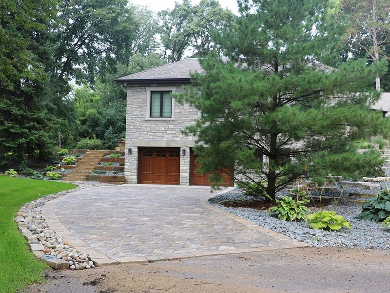 Lower Driveway and stairs leading to the patio and hot tub