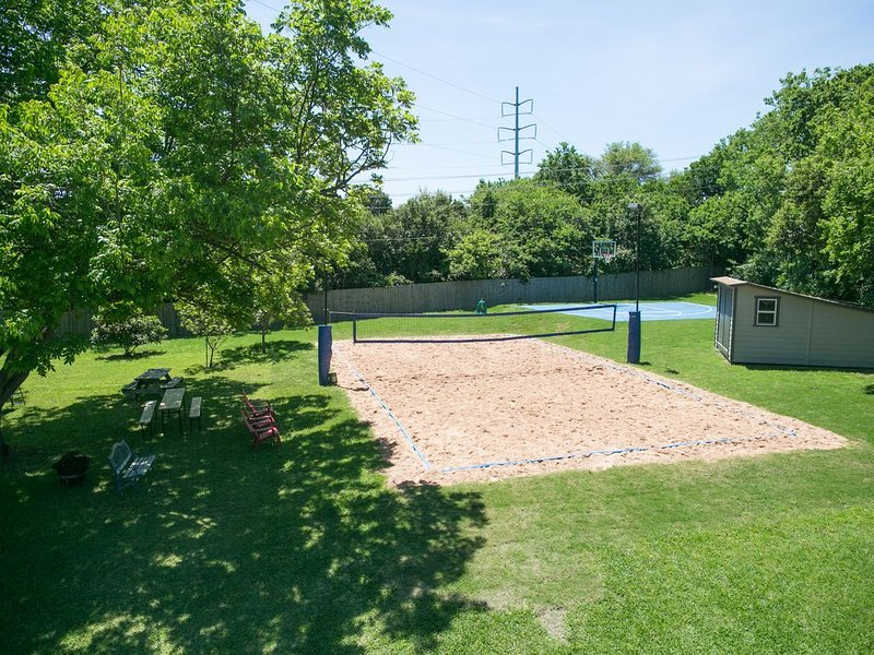 backyard with volleyball and basketball court