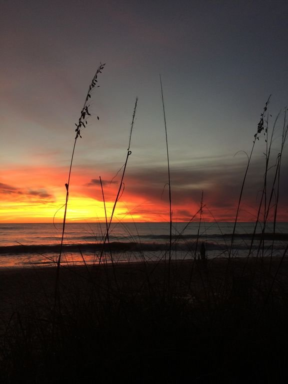 Every sunset is spectacular! This is the view when we step onto the beach.