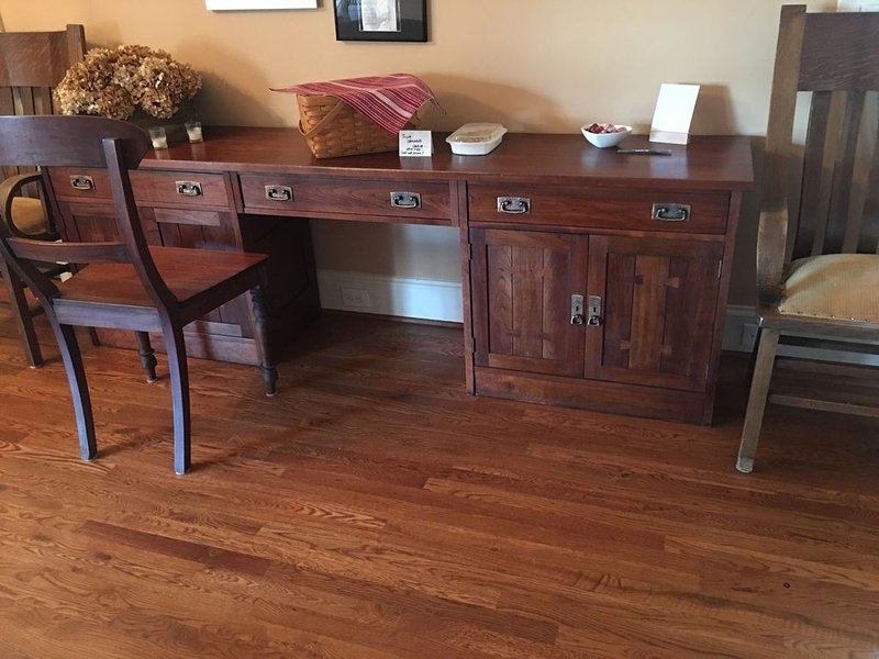 High end Executive desk ( with homemade goodies on it). Off the kitchen.