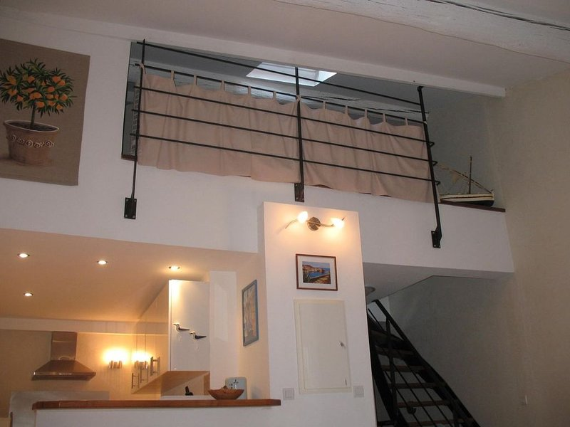 View from the living room, fully equipped kitchen downstairs, mezzanine at the top