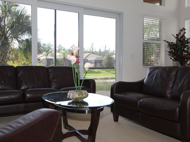 Casual sitting room looking out onto the lanai