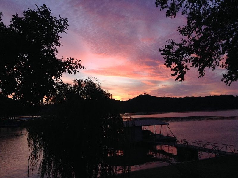 Lake House on Lake of  Ozarks on a level lot.   Boat slip and swim dock, vacation rental in Sunrise Beach