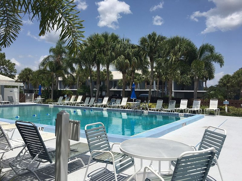 community pool, short walk from condo, with grilling options