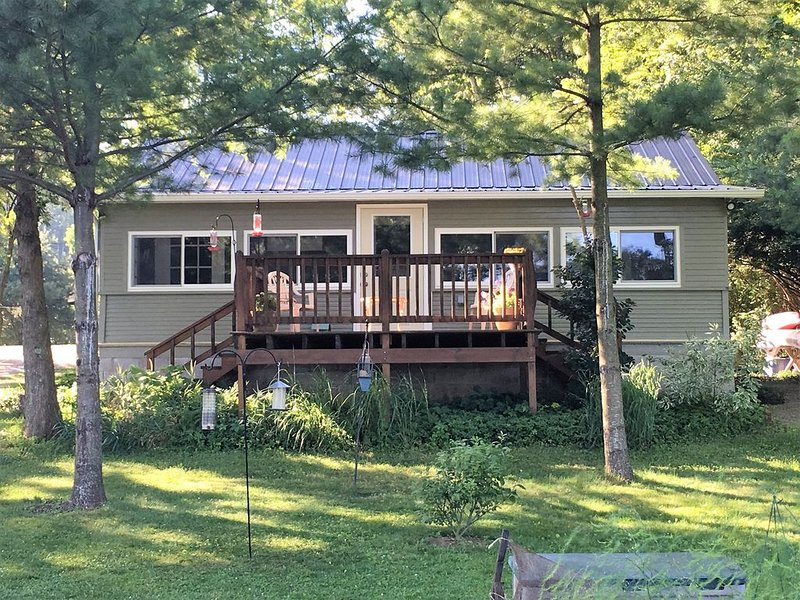 Front of the Cottage Overlooks the Yard and Lake