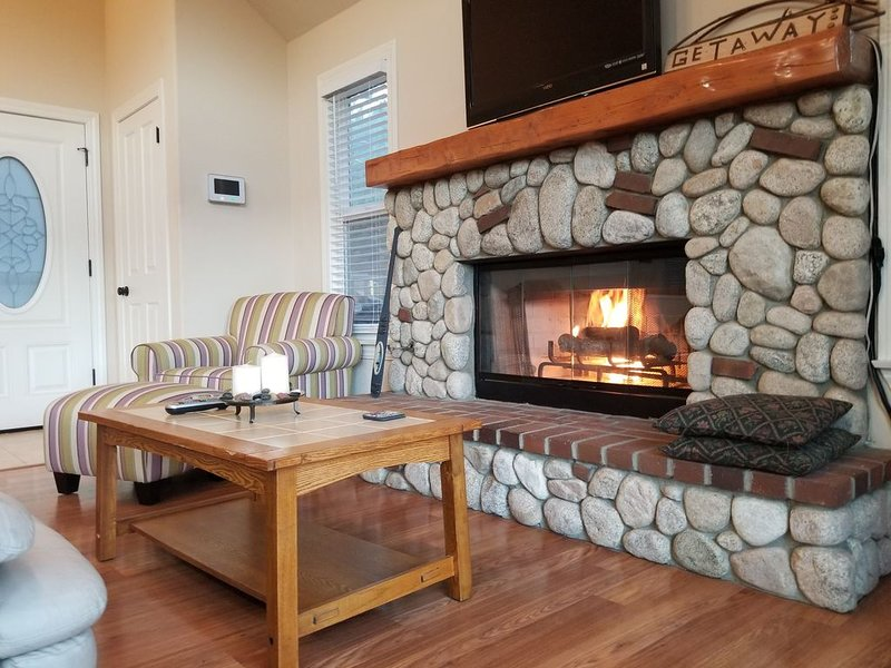 Relax in front of our warm fire. TV includes Firestick.