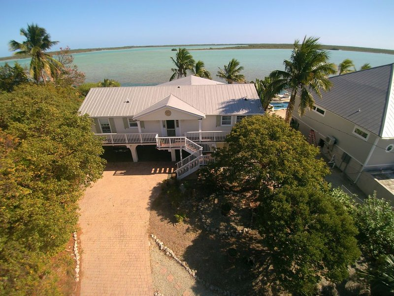 Waterfront home with open water view, dock, hot tub, private beach, dog friendly, holiday rental in Sugarloaf Key