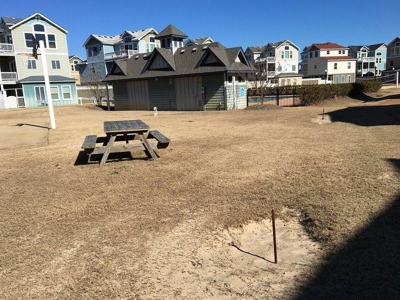 Picnic table, pool, basketball, shuffleboard and pool across the street