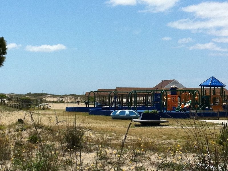 Playground and picnic areas on the beach, located next to the fishing pier